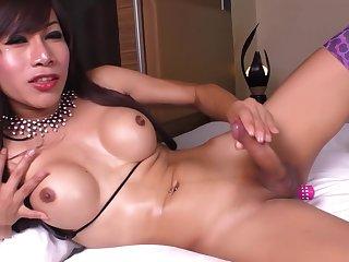 Brunette ladyboy loves her vibrator in her ass