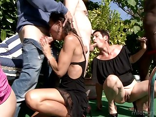 Four oversexed dudes fuck Zaza La Coquine with an increment of her girlfriends by the poolside