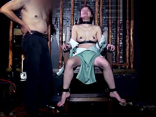 Asian Beauty in BDSM Dungeon