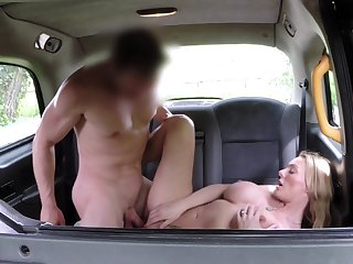 Big-boobed Stacey Saran enjoys a taxi driver's back derriere