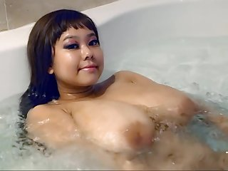 Asian babe with majuscule melons more the bathtube