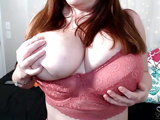 Chubby mature flashes the bulky jugs while composing to masturbate
